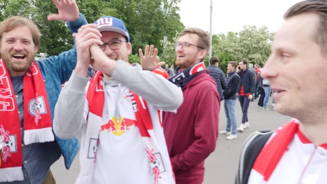 Football fans from RB Leipzig are singing in front of the stadium in the area where most Bayern Munich fans are ahead of the DFB Cup Final 2019...