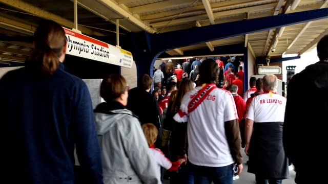 Football fans from RB Leipzig arrive at the Olympiastadion subway station prior the DFB Cup final between RB Leipzig and Bayern Muenchen at...