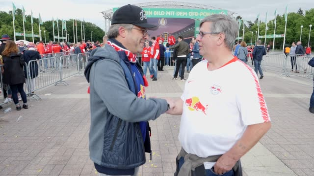 Football fans from RB Leipzig in front of the stadium ahead of the DFB Cup Final 2019 between RB Leipzig and Bayern Muenchen at Olympiastadion on May...