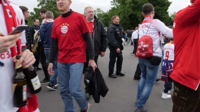 Football fans from RB Leipzig in front of the stadium in the area where most Bayern Munich fans are ahead of the DFB Cup Final 2019 between RB...