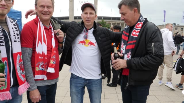 Football fans from RB Leipzig in front of the stadium with the Olympic rings in the background ahead of the DFB Cup Final 2019 between RB Leipzig and...