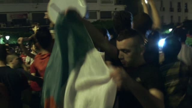 football fans in algiers were celebrating their national teams historic qualification for the second round of the world cup in brazil - qualification round stock videos & royalty-free footage