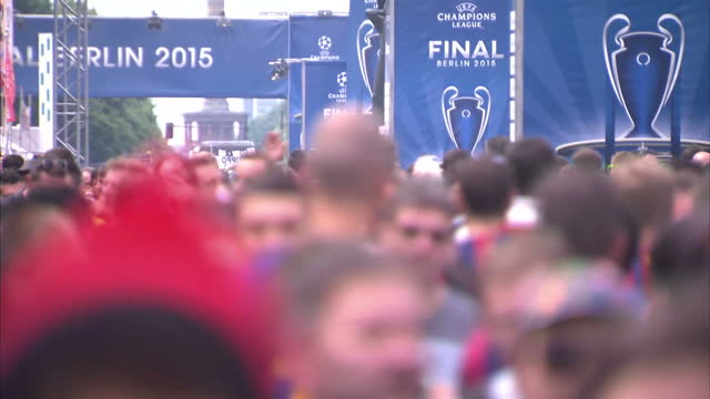 Football fans on streets wearing Barcelona and Juventus football shirts gearing up for Champions League Final