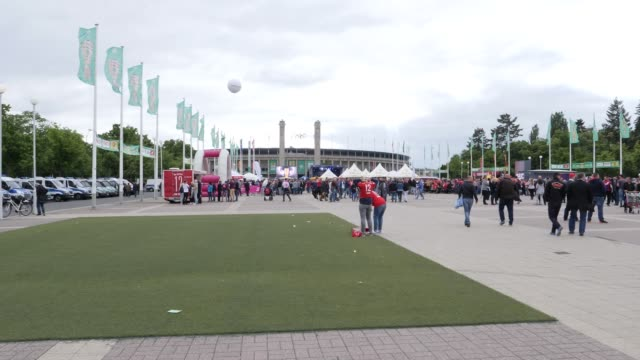 Football fans pour into the stadium ahead of the DFB Cup Final 2019 between RB Leipzig and Bayern Muenchen at Olympiastadion on May 25 2019 in Berlin...