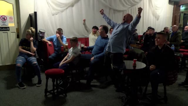 football fans react as they watch manchester united come from behind to edge rivals manchester city and delay their title celebrations - rivalry stock videos & royalty-free footage
