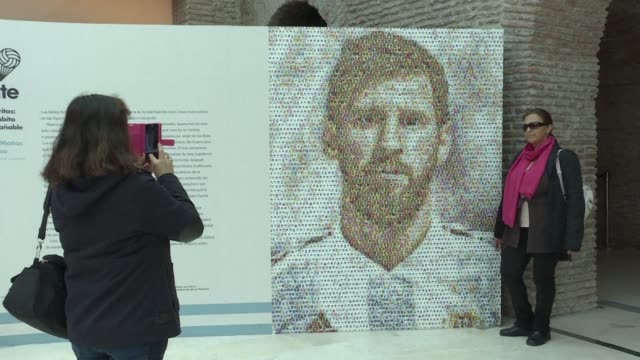 football fans visit a mural of lionel messi made of 2000 football stickers being exhibited at the casa rosada museum in buenos aires as part of a... - buenos aires video stock e b–roll