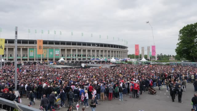Football fans waiting to get into the stadium in the area where most RB Leipzig fans are ahead of the DFB Cup Final 2019 between RB Leipzig and...