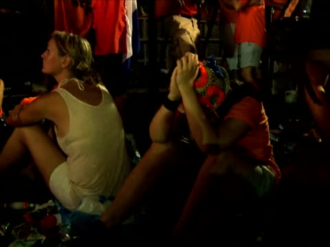 football fans watched in disbelief on big tv screens as their team lost the 2010 football world cup final to spain - bericht film und fernsehen stock-videos und b-roll-filmmaterial