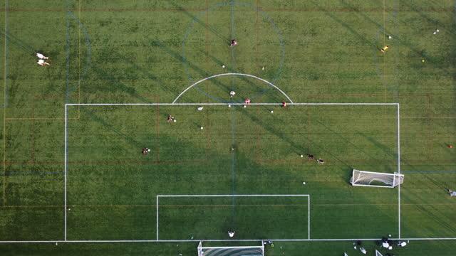 stockvideo's en b-roll-footage met voetbalvelden van bovenaf - eastenders