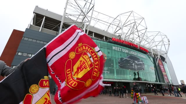 Football flags flying outside Manchester United's Old Trafford Stadium in Salford north west England on January 26 Manchester United's Old Trafford...