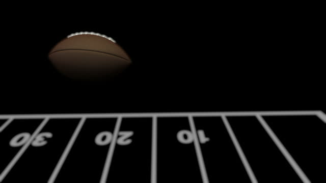 a football flies through the field goal upright. - american football pitch stock videos & royalty-free footage