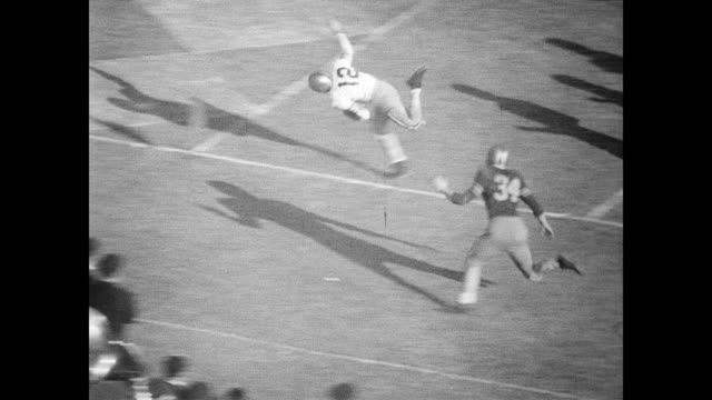 / football game begins / individual players mentioned are pepper rodgers sam hensley bob moss danny williams leon hardeman larry ruffin / georgia... - 1954 stock videos and b-roll footage