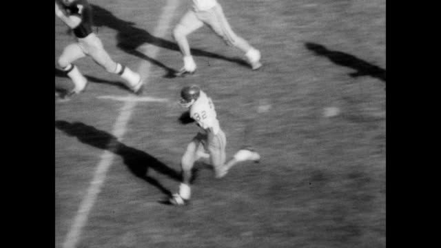 / football game between notre dame and usc / cheerleaders begin game by making the letters 'nd' on the field / game is played as crowd cheers /... - o.j. simpson stock videos & royalty-free footage