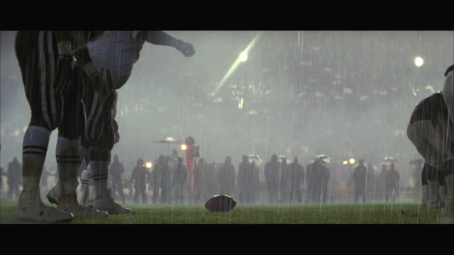 MS Football game in heavy rain