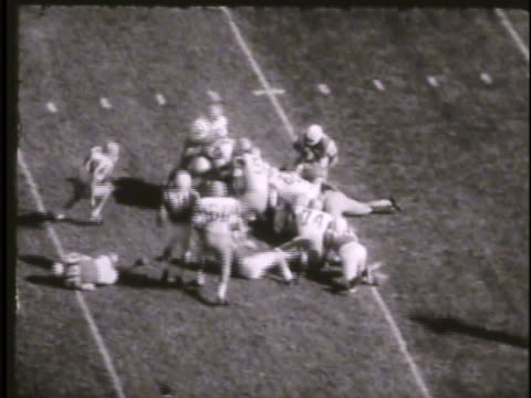 stockvideo's en b-roll-footage met football game on field in falcon stadium between air force unidentifiable team cadets in stands watching cheering head coach ben martin walking on... - 1921