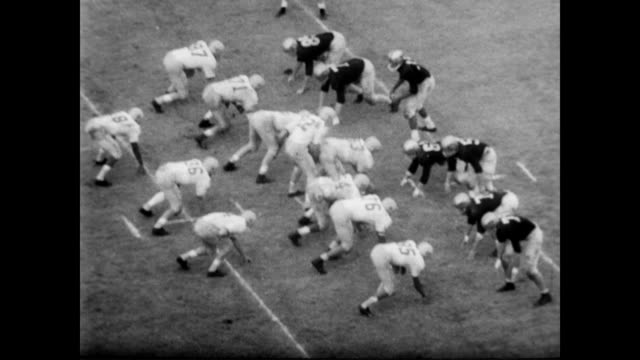 / football game played with several players mentioned during passes and touchdowns such as: don sutherin, don clark, charles lebeau, and galen cisco... - 1957 stock-videos und b-roll-filmmaterial
