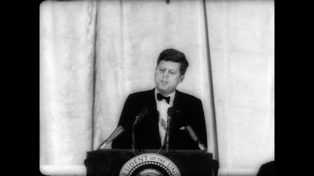 vídeos de stock e filmes b-roll de / football hall of fame dinner / jfk seated near general douglas macarthur / receives award and gives speech / jfk tells crowd of his military career... - 1961