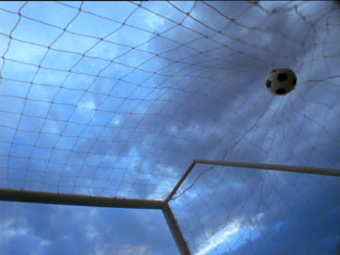 football hits back of net - netting stock videos & royalty-free footage