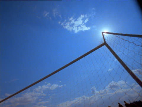 football hits back of net - netting stock videos and b-roll footage