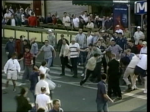 conviction upheld football hooligan conviction upheld lib england fans rioting in street plain clothes belgian police dragging england fan away... - hooligan stock videos & royalty-free footage