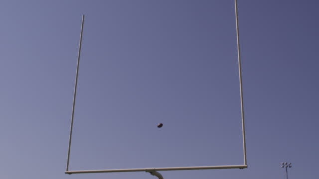 A football is kicked through in a field goal