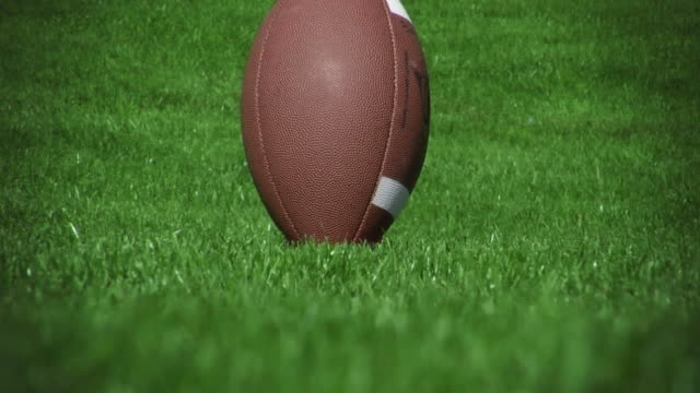 Football kicked off tee 01 (HD - Slow-Motion)