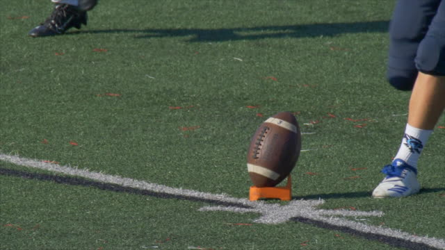 a football kicker kicking the ball. - slow motion - sporting term stock videos & royalty-free footage