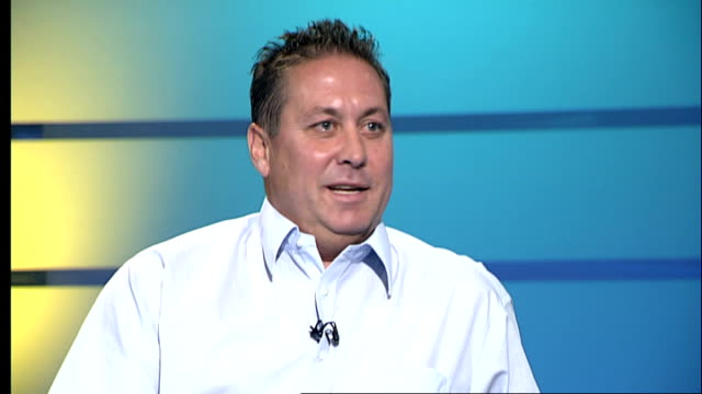 kenny sansom interview; london: gir: int sansom live studio interview sot - on bryan robson, holds up england shirt - kenny sansom stock videos & royalty-free footage