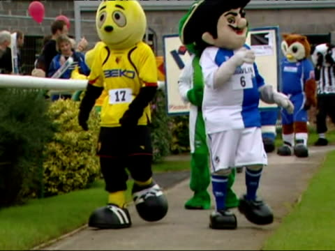 football mascots race each other in their own grand national race - funny - mascot stock videos & royalty-free footage
