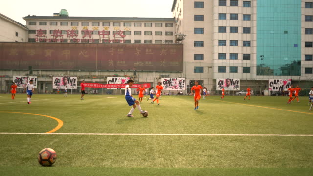 a football match is going on between students from elementary schools and middle schools in beijing dongcheng district in 2017 china will establish... - bildungseinrichtung stock-videos und b-roll-filmmaterial