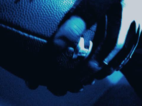 football montage - アメリカンフットボールヘルメット点の映像素材/bロール