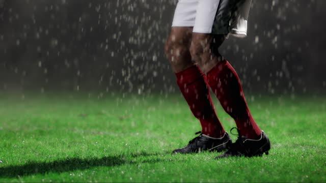 slo mo football player chest trapping the ball - インパクト点の映像素材/bロール