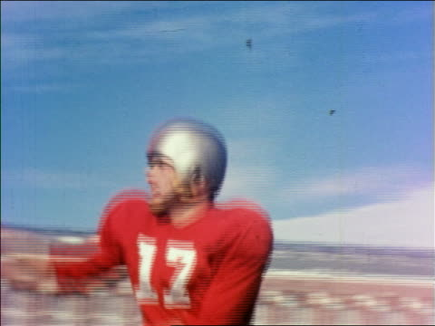 pan football player in uniform running catching ball / iowa state university / educational - 1951年点の映像素材/bロール