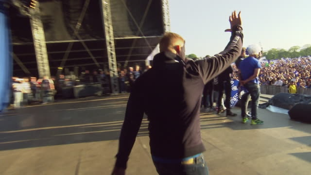 football player kasper schmeichel waves to an enormous crowd as he joins others on stage as they celebrate leicester city fc's surprise win of the... - leicester stock videos & royalty-free footage