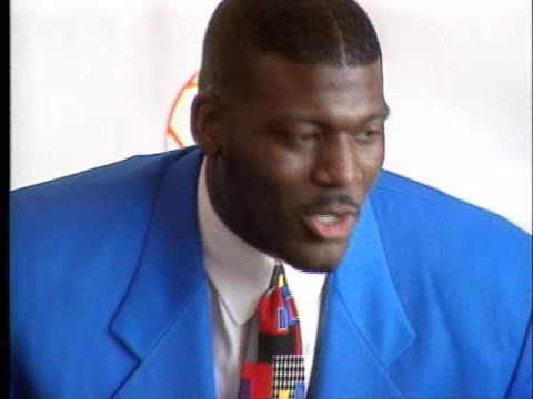 nfl football player larry johnson speaks to the press before presenting a $1000 donation to the dallas park and recreation department - sport stock-videos und b-roll-filmmaterial