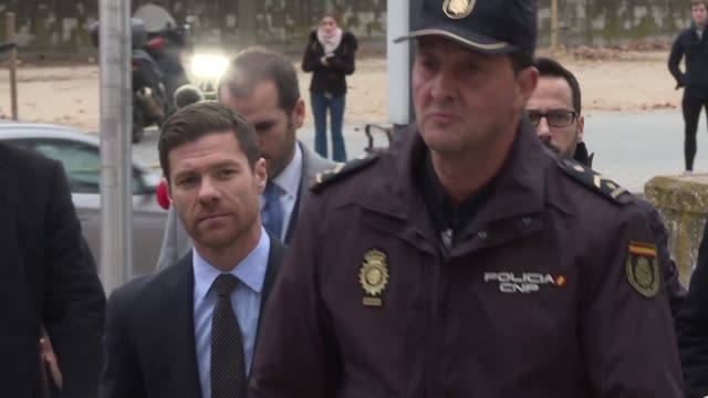 Football player Xabi Alonso arrives at Madrid's courthouse ahead of a tax evasion charge on the same day his former Real Madrid teammate Cristiano...