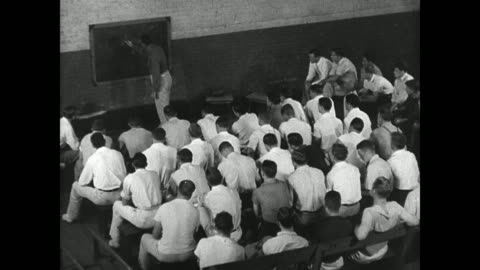 football players exercising on field rocking on stomachs sitting in class coach drawing play on blackboard players in uniform practicing on field... - 1936 stock videos & royalty-free footage
