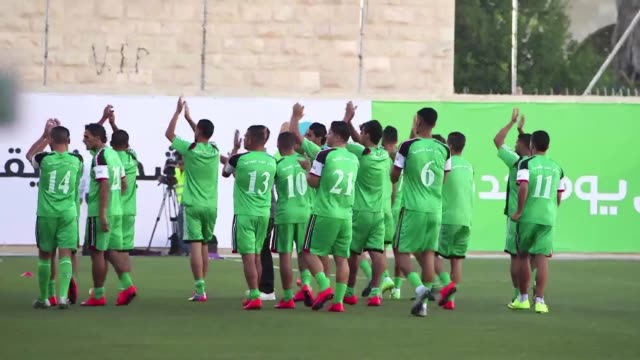 football players from the gaza strip kicked off the return leg of a match against the west banks al ahli on friday - football strip stock videos & royalty-free footage