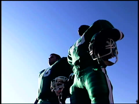 Football players outdoors with helmets