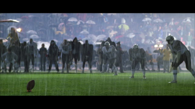 ws pan football players running after the kickoff - soccer glove stock videos and b-roll footage