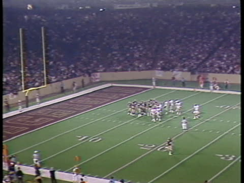 1984 ha ws football players walking on field during game between usfl teams pittsburgh maulers and michigan panthers / pontiac, michigan, usa - football goal post stock videos and b-roll footage