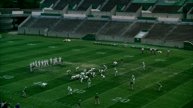 WS Football practice starting on football field / Unspecified