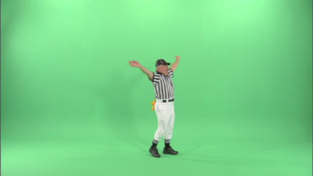 ws, football referee blowing whistle and signaling to stop the clock / studio - neenah stock videos & royalty-free footage