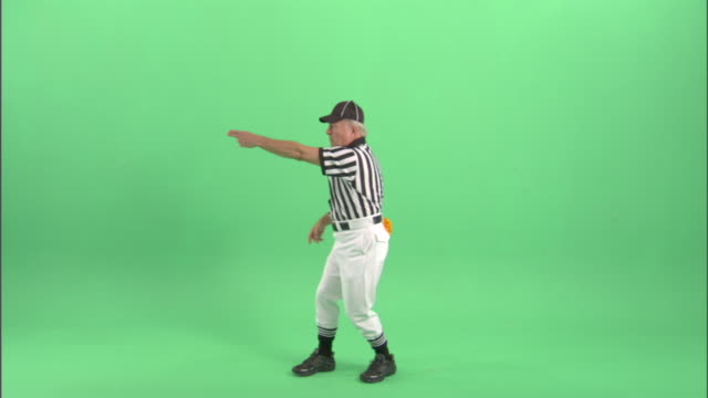 WS, Football referee gesturing in studio, portrait