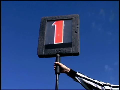 football referee holding first down marker - アメフト ファーストダウン点の映像素材/bロール