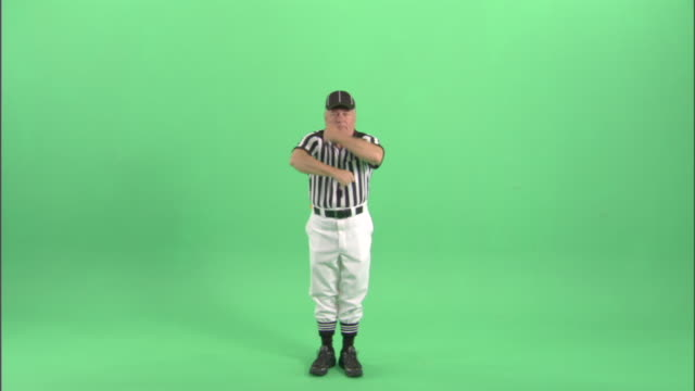 "ws, football referee signaling ""false start"" in studio, portrait - neenah stock videos & royalty-free footage"