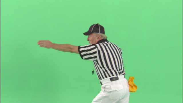 MS, Football referee signaling 'first down' in studio