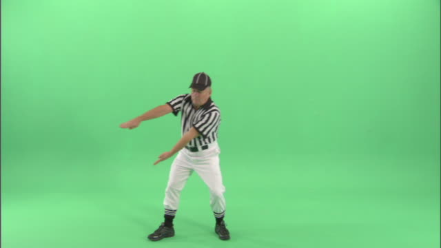 "ws, football referee signaling ""intentional grounding"" in studio, portrait - wide shot stock videos & royalty-free footage"