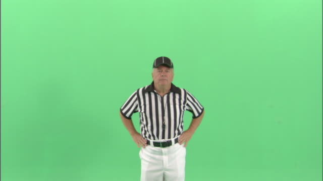 MS, Football referee signaling 'off sides' in studio, portrait