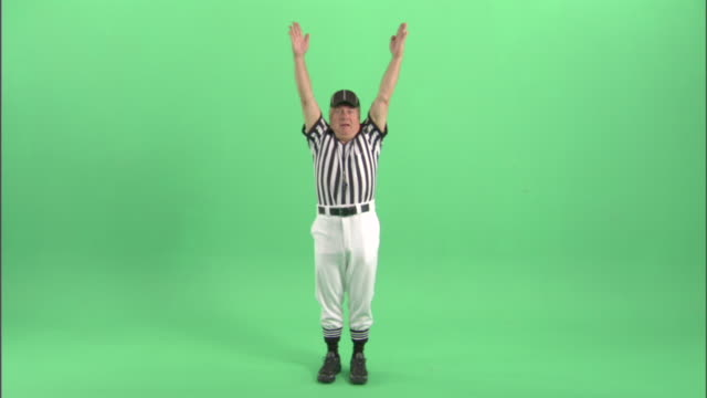 "ws, football referee signaling ""touchdown"" in studio, portrait - neenah stock videos & royalty-free footage"